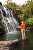 Trekker looks at wild waterfall in Horton Plains National Park Royalty Free Stock Photography