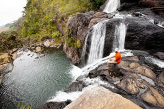 Trekker looks at wild waterfall in Horton Plains National Park, Stock Photos
