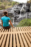 Trekker looks at wild waterfall in Horton Plains National Park, Royalty Free Stock Photography