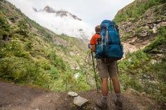 Trekker in lower Himalayas. Nepal Royalty Free Stock Images