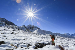 Trekker nubche summit  beside of everest from everest trek Stock Image