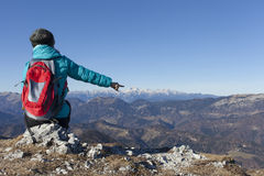 Trekker pointing on Mount Triglav Royalty Free Stock Image