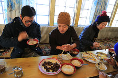 Trekker rest for food in lodge cabin from everest trek Stock Image