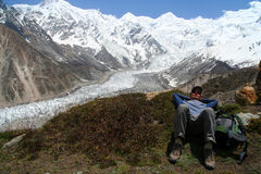 Trekker Resting. In front of Nanga Parbat Stock Photo