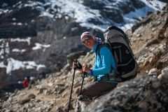 Trekker rests on stone in Khumbu valley on a way to Everest Base. Camp Royalty Free Stock Photography