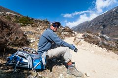 Trekker rests on a way to Renjo La pass in Everest region, Nepal. Trekker rests on a way to Renjo La pass in Everest region. Nepal Royalty Free Stock Photography