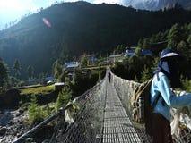 Trekker on rope bridge in everest basecamp stock video footage