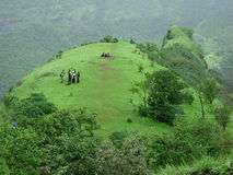 Trekker's Final Destination. Trekkers resting on mountain top Royalty Free Stock Image