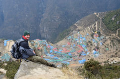 Trekker sitting above Namche Bazaar town,Nepal.Asia royalty free stock photo