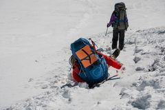 Trekker stuck in the hole in snow while crossing Cho La pass in Stock Image