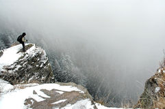 Trekker on the summit at winter Royalty Free Stock Photos