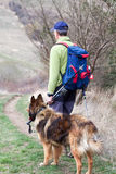 Trekker on the trail with his dog Stock Photos