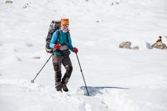Trekker is walking by Renjo La pass in Everest region Royalty Free Stock Image