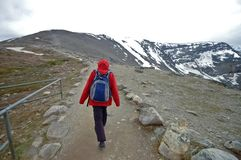 Trekker walks to the mountain peak Stock Image