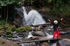 Trekker woman rain forest national park. Trekker woman enjoy rain forest national park stock images