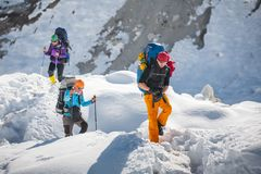 Trekkers crossing Gokyo glacier in Khumbu valley on a way to Eve. Rest Base camp Stock Image