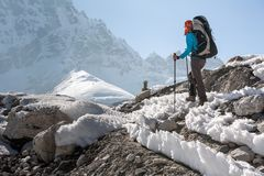 Trekkers crossing Gokyo glacier in Khumbu valley on a way to Eve Stock Image