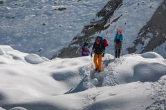 Trekkers crossing Gokyo glacier in Khumbu valley on a way to Eve. Rest Base camp Stock Photography