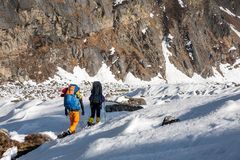 Trekkers crossing Gokyo glacier in Khumbu valley on a way to Eve. Rest Base camp royalty free stock image