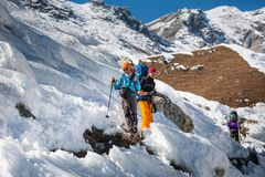 Trekkers are crossing Gokyo glacier in Khumbu valley on a way to. Everest Base camp Royalty Free Stock Photos