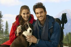 Trekkers with dog taking rest Stock Photography