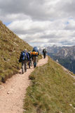 Trekkers in The Dolomites. Italy Royalty Free Stock Photo
