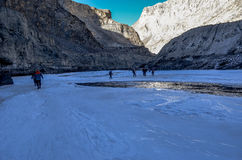Trekkers on frozen zanskar in chadar trek Royalty Free Stock Images