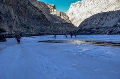 Trekkers on frozen zanskar in chadar trek royalty free stock images