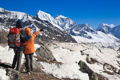 Trekkers in Himalayas Stock Photos