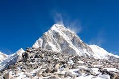 Trekkers on Kala Patthar with Pumori behind Royalty Free Stock Photos