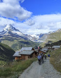 Trekkers and matterhorn. Trekkers getting at the village Royalty Free Stock Images