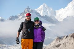 Trekkers are posing at camera in Khumbu valley on a way to Evere. St Base camp Royalty Free Stock Photo