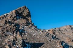 Trekkers returning to Gilmans Point Kilimanjaro Stock Photo