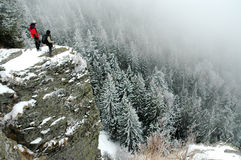 Trekkers on the summit at winter Royalty Free Stock Image