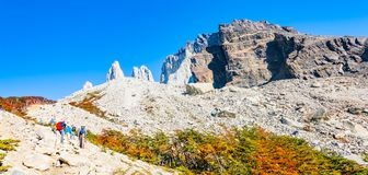 Trekkers in Torres del Paine National Park in Autumn, Patagonia, Royalty Free Stock Photography