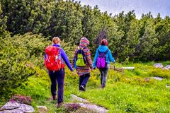 Trekkers walking on mountain path royalty free stock photography