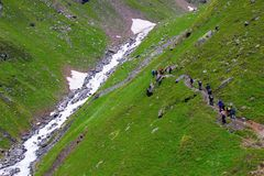 Trekkers walking towards Hansbeshan Peak 5240m glacier. Himachal Pradesh. Northern India Royalty Free Stock Photos