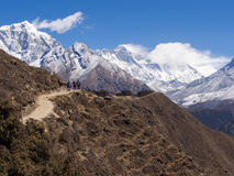 Trekkers Walking on the Trail to Everest Base Camp in Nepal Stock Photo