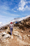 Trekkers walking uphill with blue sky Royalty Free Stock Photography