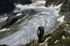 Trekking above the Tiefmatten Glacier. In the Swiss Alps. The Tiefmatten glacier flows down from the west flank of the Matterhorn and the north face of the Dent Stock Image