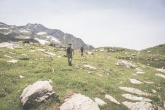 Trekking in alpine environment, desaturated crispy image Stock Image