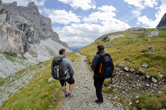 Trekking in the alps. Two friends are trekking in the Alps Royalty Free Stock Photo