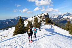 Trekking in the alps. 3 people on snowshoes in the french alps in winter stock photos