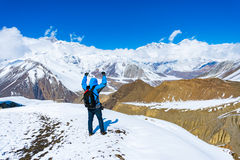 Trekking in Annapurna region, with Annapurna South in background, Nepal. Stock Photo