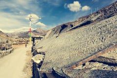 Trekking around Annapurnas and passing buddhist writings. Stock Image