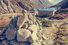 Trekking around Annapurnas and passing buddhist writings. Stock Photography
