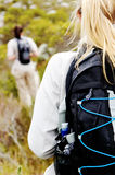 Trekking backpack. Closeup shot of a backpack on a womans back hiking outdoors stock photo