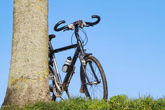 Trekking bike leaning Royalty Free Stock Images