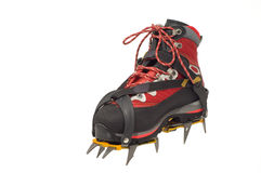 Trekking boot with the crampon. Isolated on the white background Stock Images