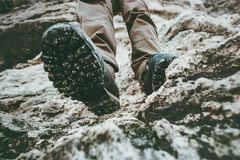 Trekking boots feet traveler climbing at rocky mountains Travel Lifestyle. Wanderlust adventure concept summer vacations view under sole perspective Stock Images